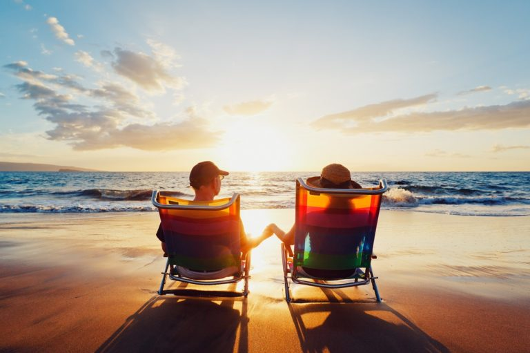 two people relaxing by the beach