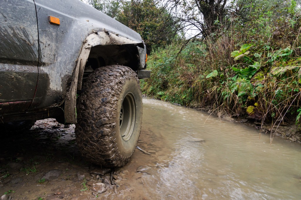 Off-road vehicle in mud