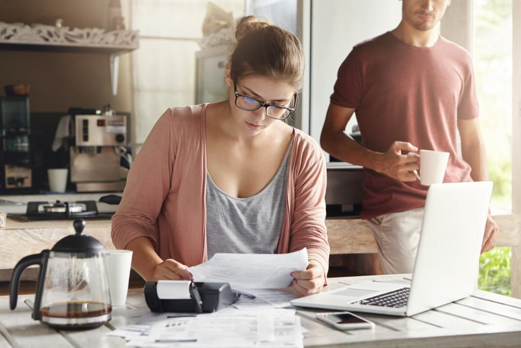 woman checking her bills