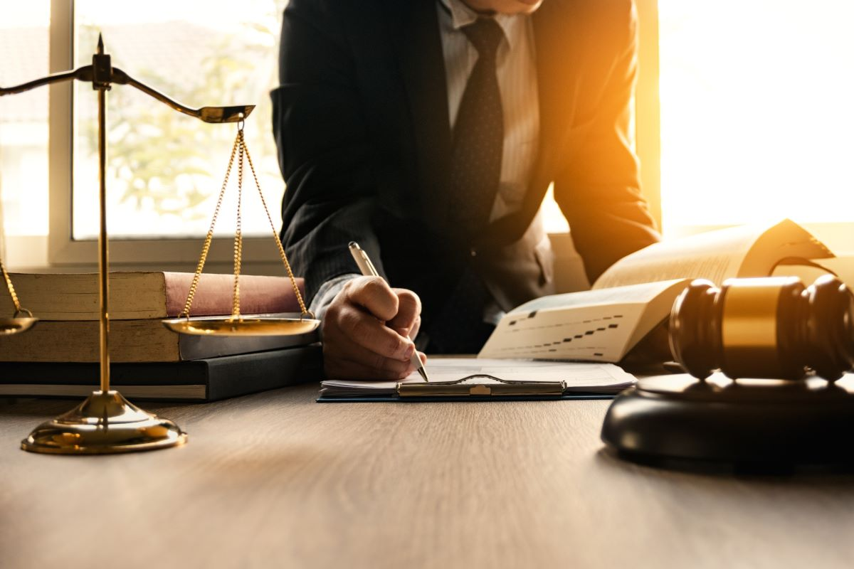 lawyer writing on a paper