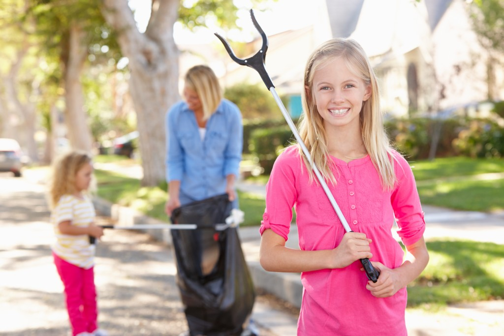 girl helping clean the community
