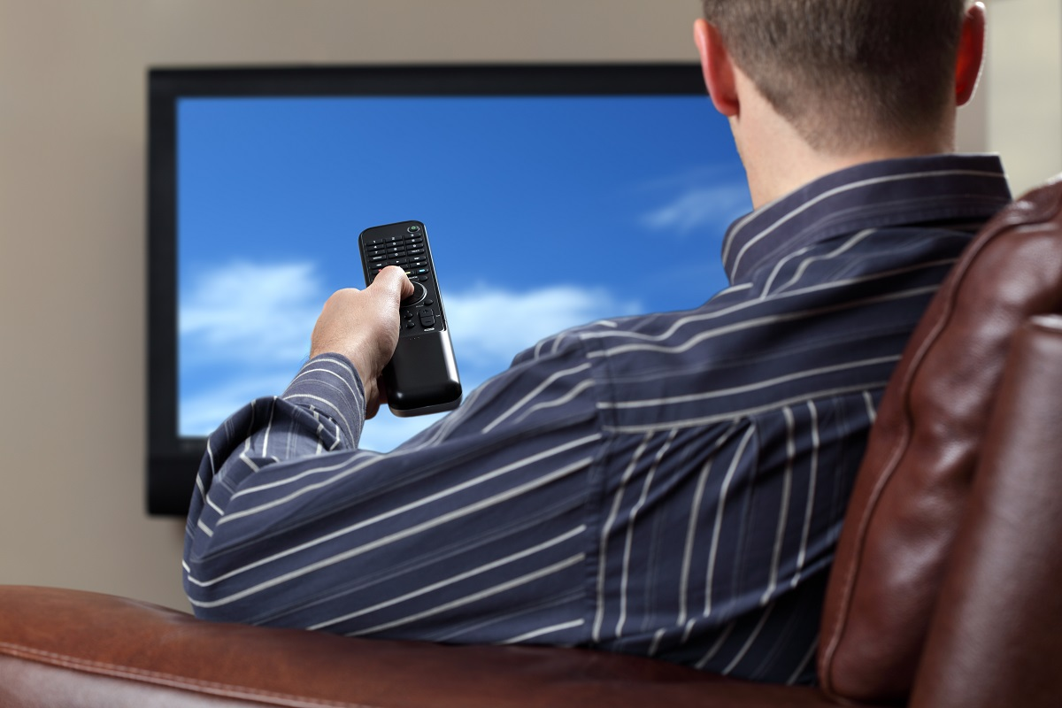 person watching a television
