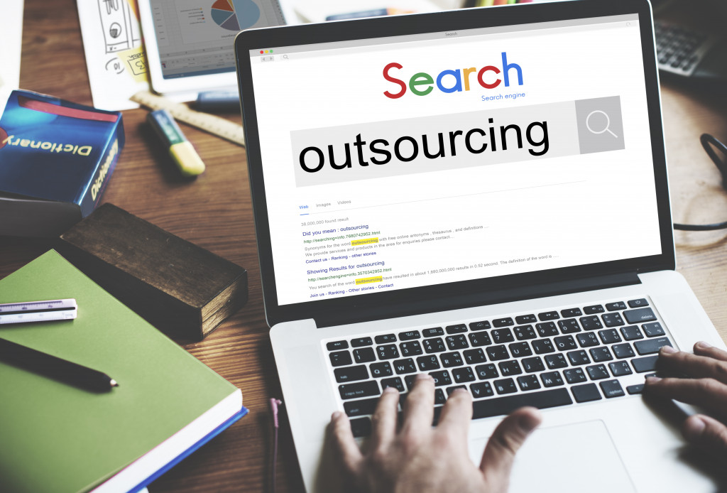 business owner googling 'outsourcing'