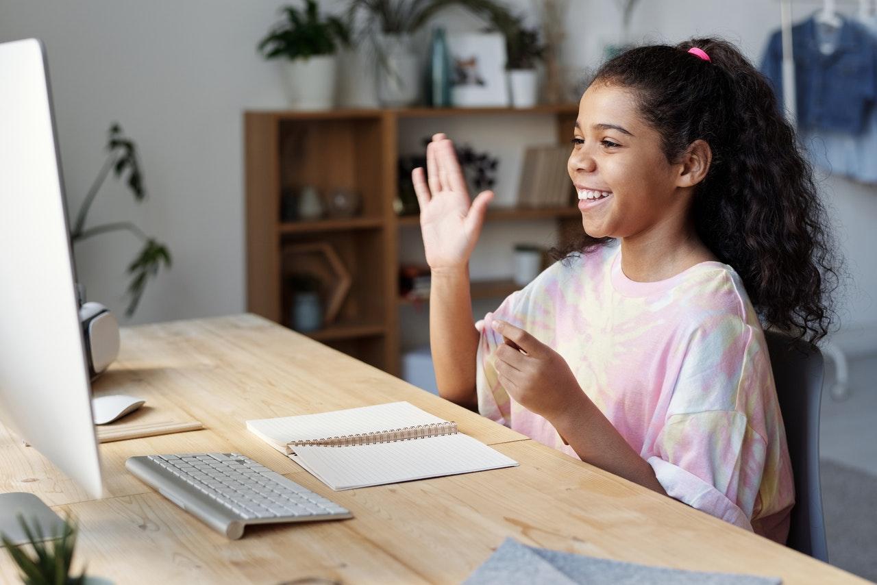 girl attending online classes reciting