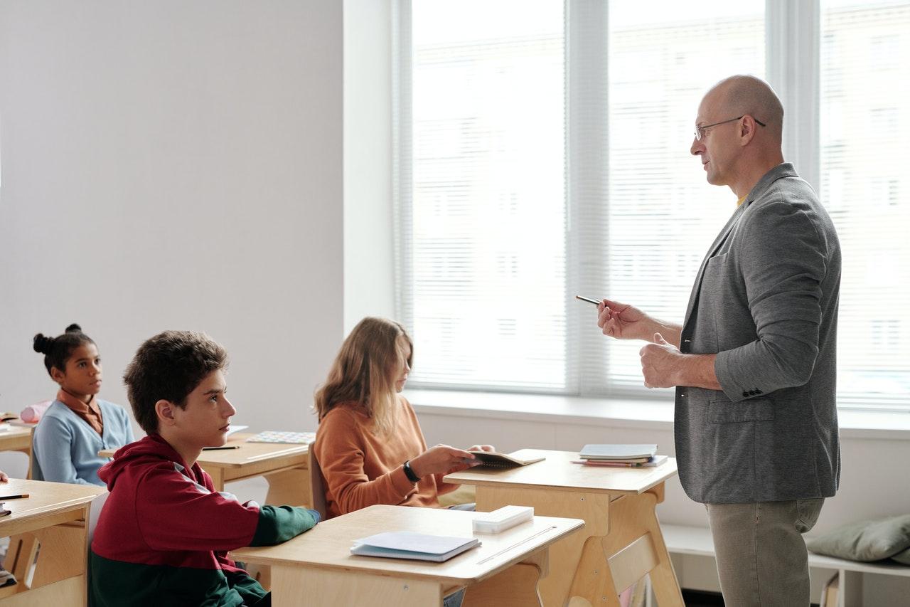 professor teaching inside a classroom