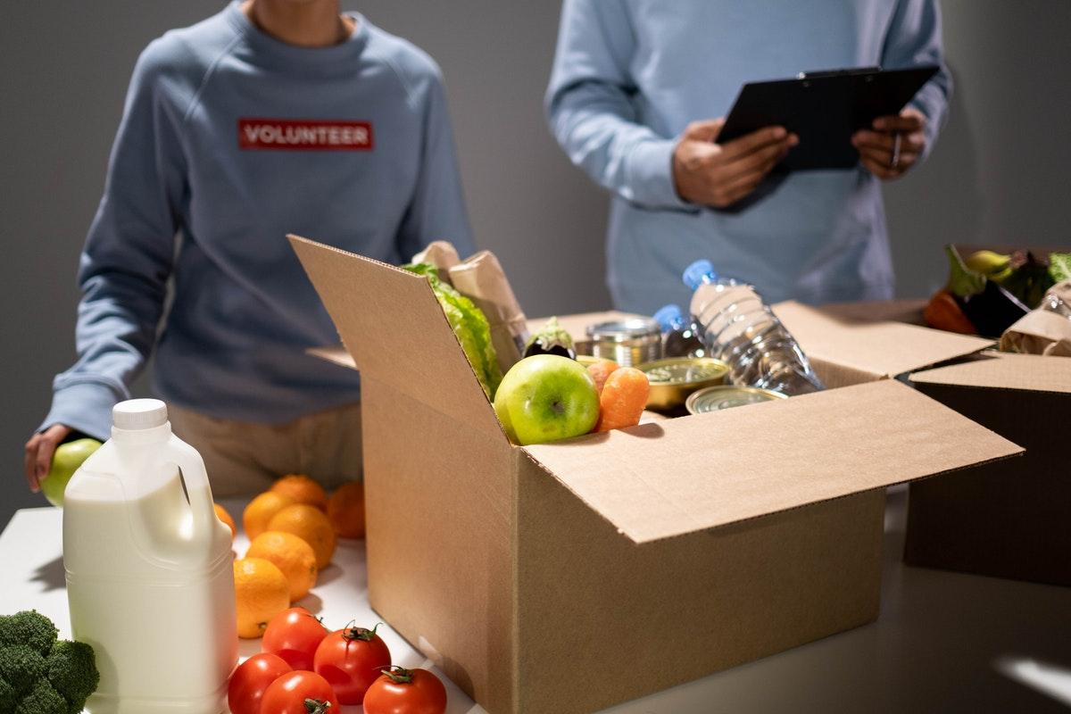 volunteer donating goods