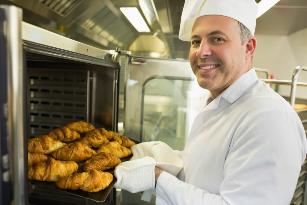 pastry chef making croissants